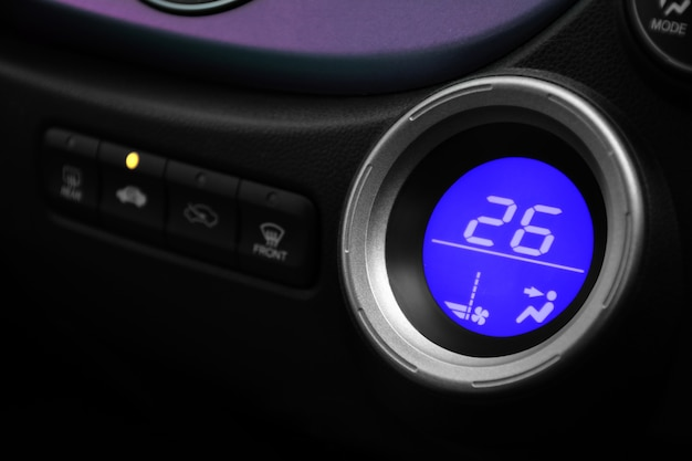 Digital controller air conditioner with blue light in car. automotive concept.