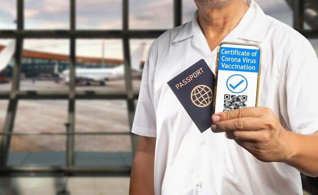 Digital covid vaccination certificate or vaccine passports  on mobile phone.