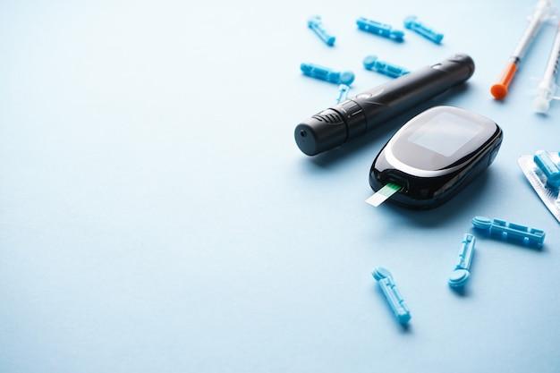 Digital glucometer and syringes