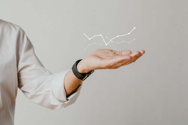 Digital graph with businessman hand overlay