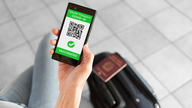 Digital health passport app for smartphone with vaccinated sign and quad code
