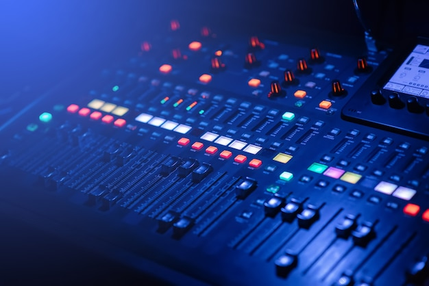 Digital music mixer has a power button running in low light conditions