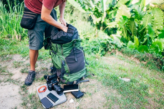 Digital nomad keeping your belongings in the backpack