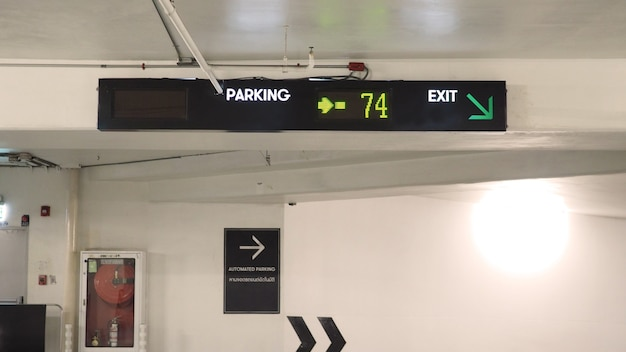 Digital parking signs with showed available space by yellow color.