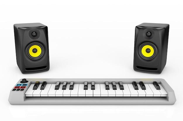 白い背景の上のオーディオスピーカーとデジタルピアノシンセサイザー