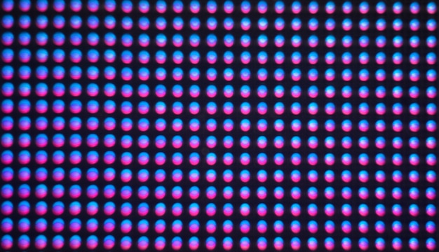 Digital screen background. color screen monitor or tv with glitch pixels and leds close up.
