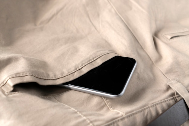 Digital spartphone in a persons pants or jeans back pocket, modern communication and internet connections