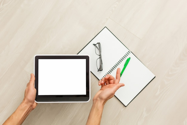 Digital tablet computer with isolated screen in male hands background