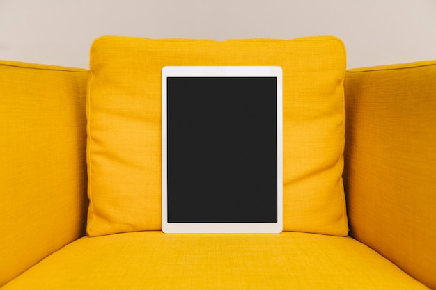 Digital tablet laying on armchair