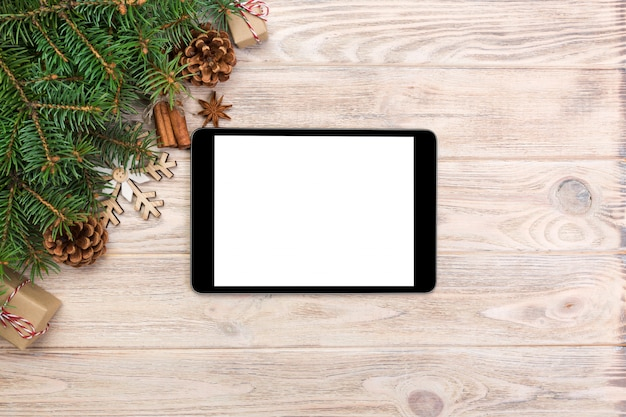 Digital tablet mock up with rustic christmas wood  decorations for app presentation, top view