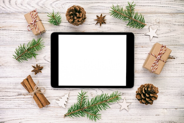 Digital tablet mock up with rustic vintage,  christmas wooden  decorations for app presentation, top view