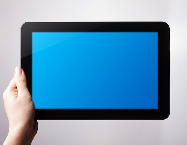 Digital tablet mockup in woman hands