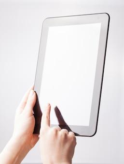 Digital tablet mockup in woman hands