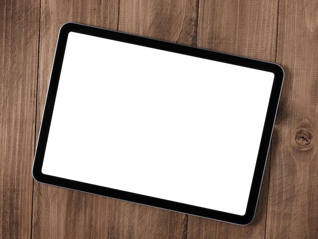 화면이 분리된 나무 테이블에 있는 디지털 태블릿