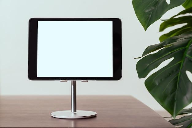 Digital tablet screen is blank on table