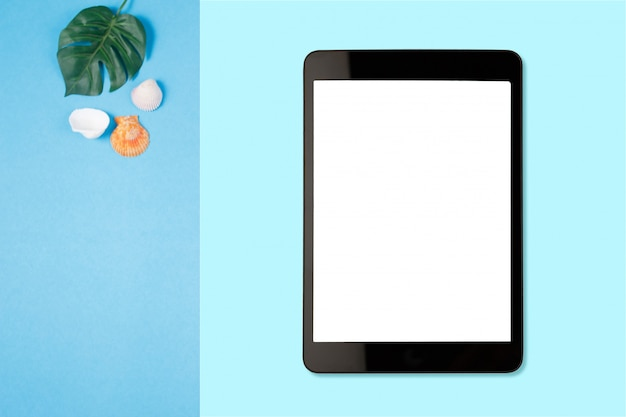 Digital tablet with blank screen on pastel color background, flat lay photo