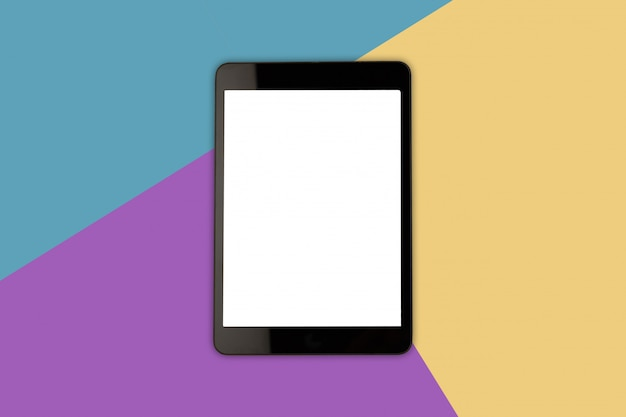 Digital tablet with blank screen on pastel color background