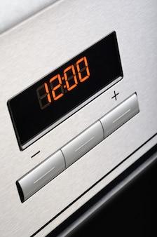Digital timer of stainless steel oven. macro shot.