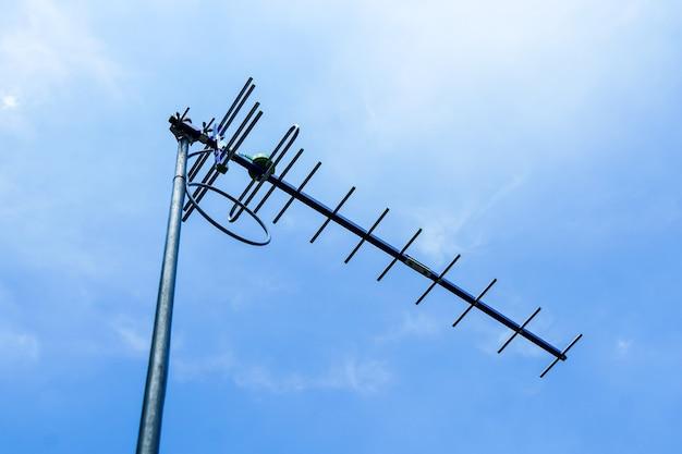 Digital tv antenna bright sun sky background