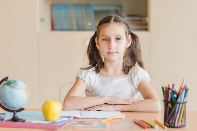 Diligent girl sitting at desk