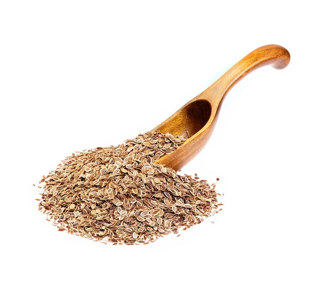 Семена укропа на деревянной ложке. макро фото.