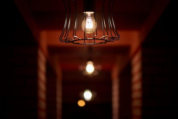 Dim light bulbs in the dark corridor.