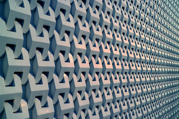 Diminishing perspective of a building decorated with metallic grey outer wall background