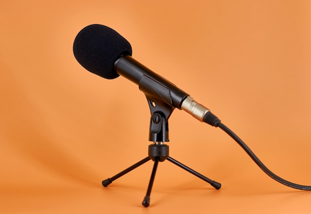 Dinamic microphone on a tripod table stand with protective sponge.