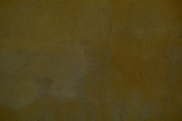 Dingy dark ochre painted wall background texture for vintage or retro themes