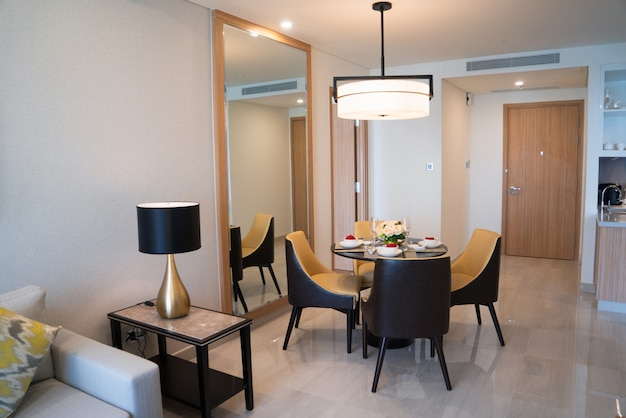 Dining area of comfortable studio flat or hotel room.