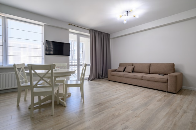 Dining or living room with white round dining table and sofa