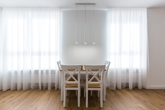 Dining room in white modernist colors