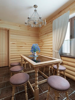 통나무 스타일의 내부 창가의 식탁과 의자
