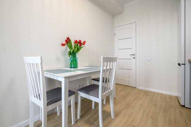 Dining table at cozy modern kitchen interior