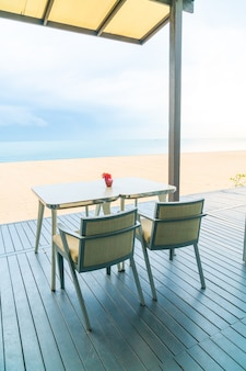 Dining table in restaurant by the sea