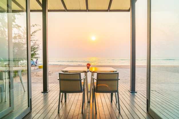 Dining table in restaurant with sea beach views