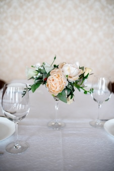 Dining table setting decorated with flowers.