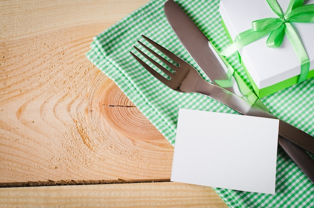 Dining table setting. empty tag and present.