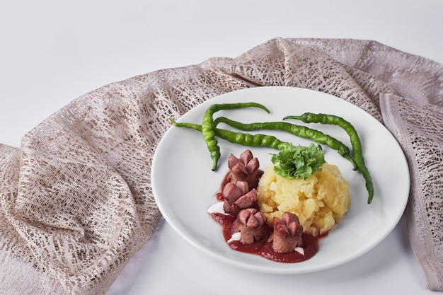 Dinner menu with fried sausages, mashed potatoes and beans.