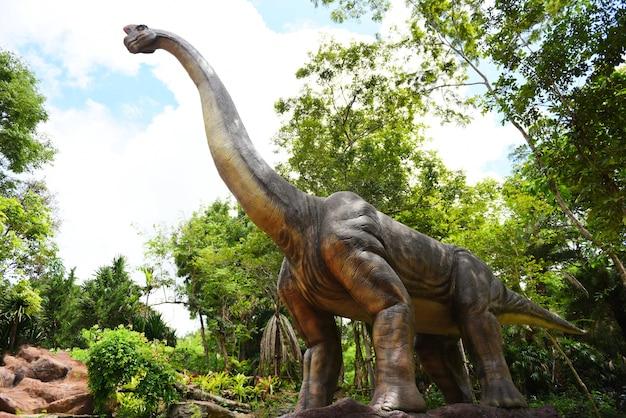 Dinosaur statue in the forest park, diplodocus, mamenchisaurus