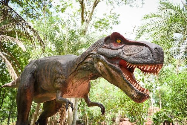 Dinosaur statue in the forest park tyrannosaurus rex