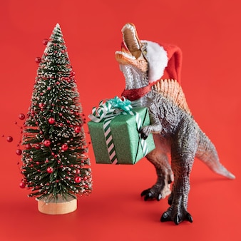 Dinosaur toy with gift and tree