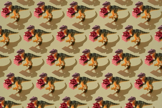 Dinosaur with gift box pattern on green background