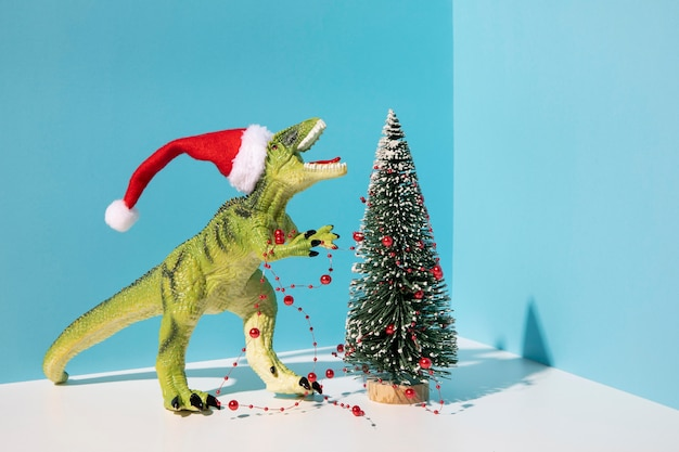 Dinousaur toy near christmas tree