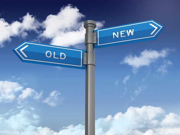 푸른 하늘에 오래 된 새로운 단어와 방향 표시 시리즈