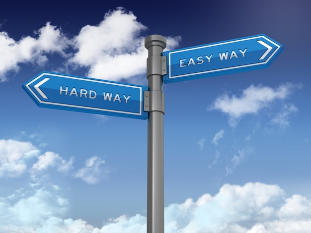 Directional sign with hard way and easy way words on blue sky