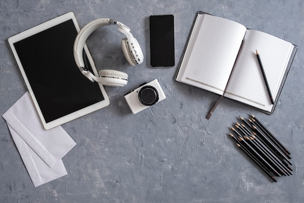 Directly above shot of office desk and stationery on gray background