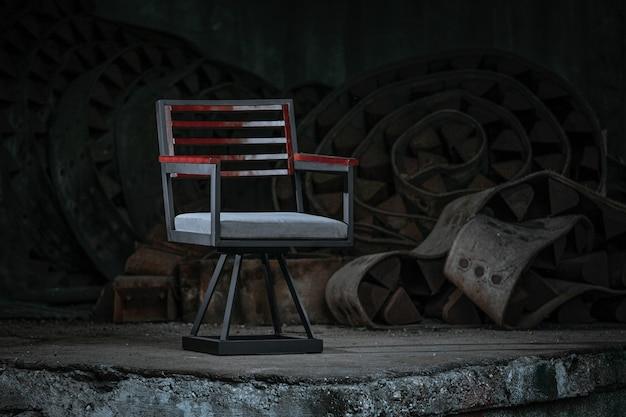Director's chair with a weathered red paint placed with industrial materials