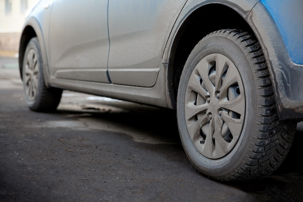 Dirt and dust on the body and wheels of a car chemistry and salt