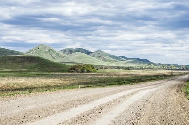 Dirt road along the ridge karamuruntau ural mountains  photographed in russia in the orenburg region in saraktashsky district